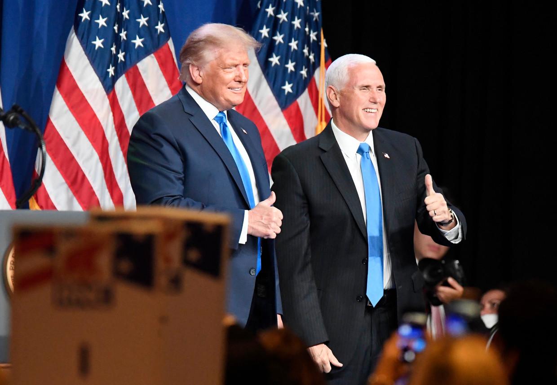 Donald Trump en Mike Pence op de Republikeinse conventie.  Beeld Photo News
