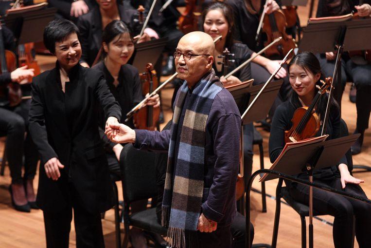 Componist Chen Qigang met het Juilliard Orkest in 2018. Beeld Getty Images