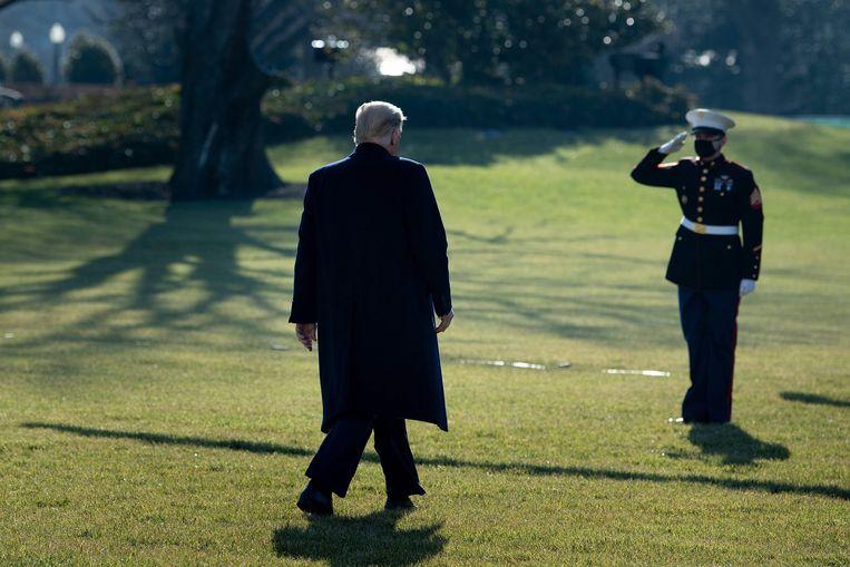 President Donald Trump in de tuin van het Witte Huis. Beeld AFP