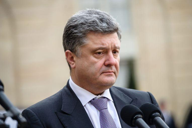 De president van Oekraïne Petro Porosjenko zegt dat de overheid een wapenstilstand probeerde te garanderen. Beeld BELGAIMAGE