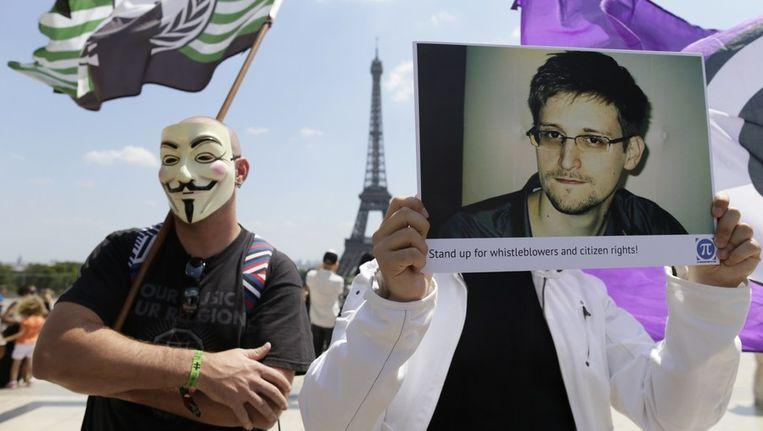 Supporters van klokkenluider Edward Snowden. Beeld afp