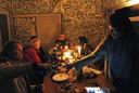 Nieuwjaarsborrel met kaarslicht bij kunstenaar Andre.