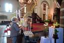 Kaarsje aansteken bij heilige  Anthonius