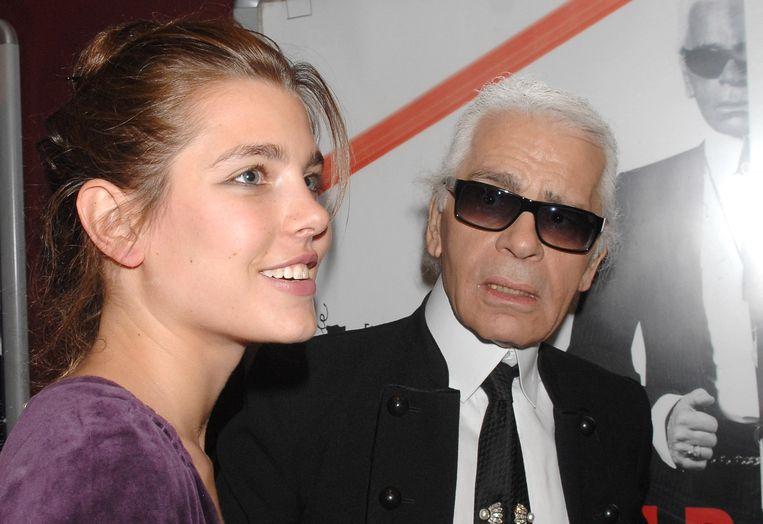 Charlotte en designer Karl Lagerfeld in 2007 Beeld BrunoPress/Abaca Press
