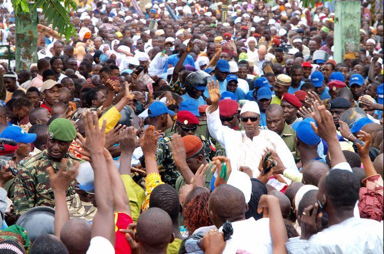 President Condé te midden van zijn aanhangers, afgelopen november. Beeld Photo News