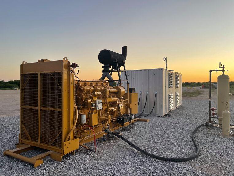Een gasgenerator levert de stroom voor het mijnen van bitcoins voor een datacenter in Texas. Beeld Hollandse Hoogte / AFP