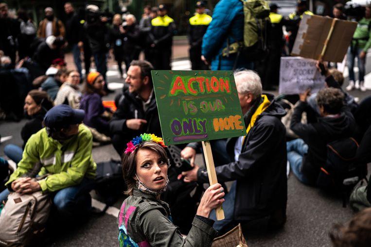 Activisten van Extinction Rebellion eerder deze week in Den Haag. Beeld Joris van Gennip