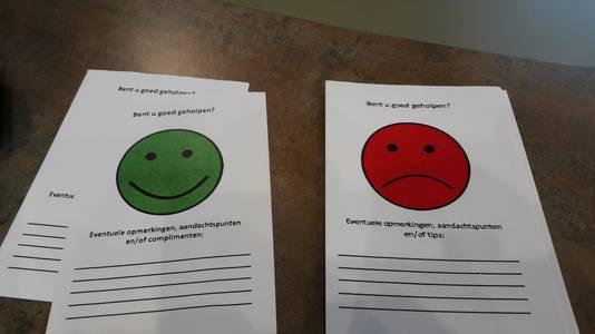 Een groene smiley voor complimenten, een rode voor klachten.