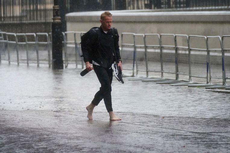 Zware regenval in Londen.  Beeld AP