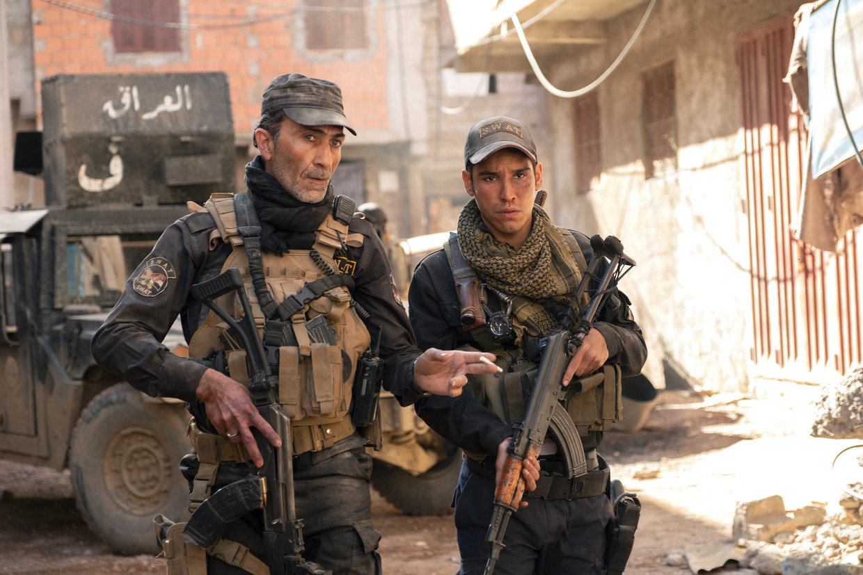 Suhail Dabbach en Adam Bessa in 'Mosul'. Beeld JOSE HARO/NETFLIX