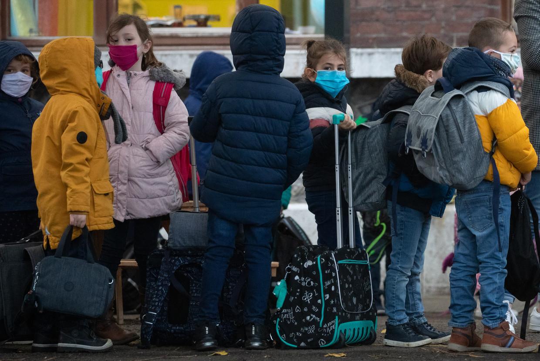 Kinderen moeten terug naar school na een langere herfstvakantie. Beeld BELGA