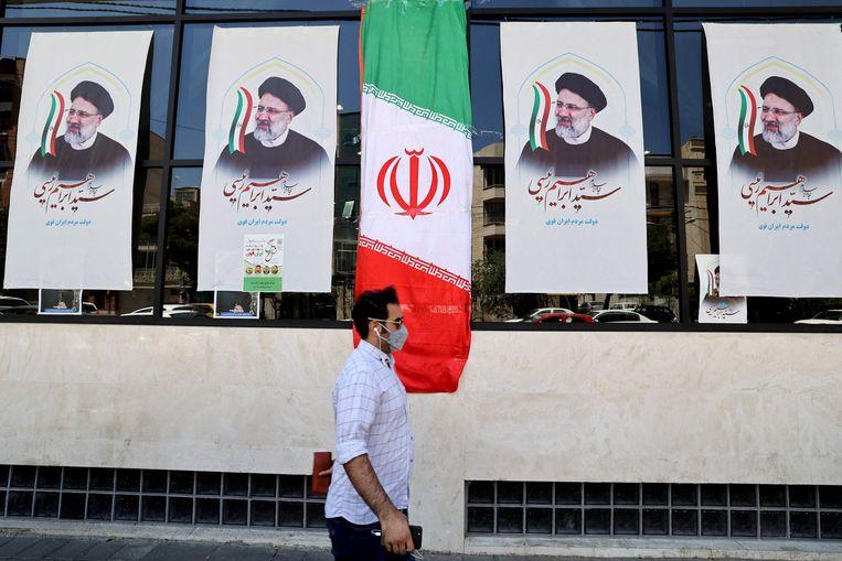 De stemmen moeten nog worden geteld, maar veel Iraniërs twijfelen er niet aan wie er zal winnen: Ebrahim Raisi.  Beeld AFP