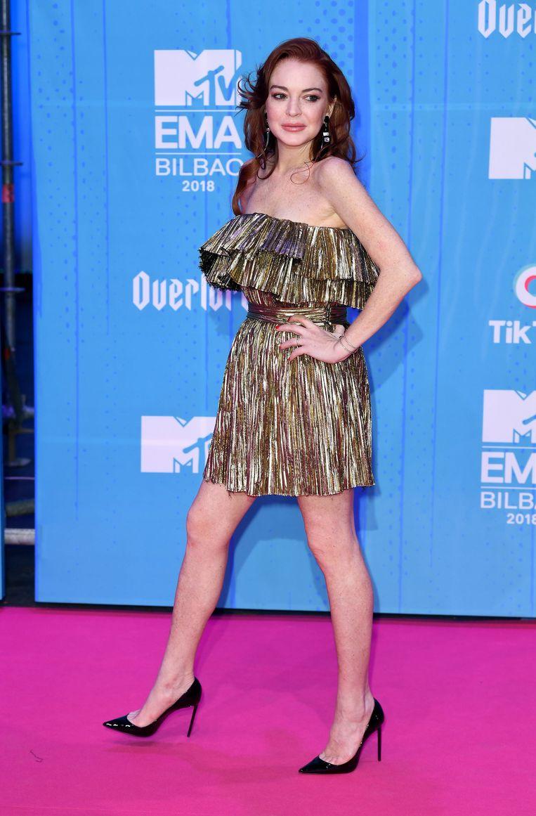 Lindsay Lohan ging voor een kort, goud jurkje.