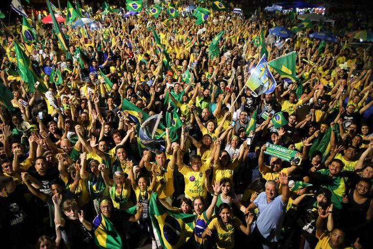 Aanhangers van Bolsonaro vieren feest in hoofdstad Brasilia. Beeld AFP