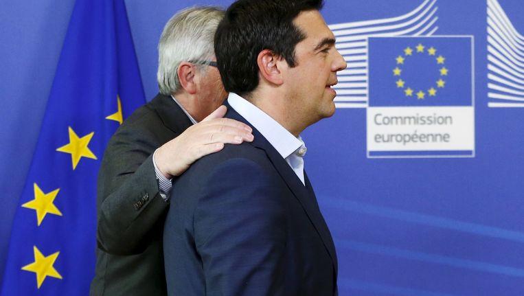 Juncker en Tsipras bij hun overleg in Brussel. Beeld REUTERS