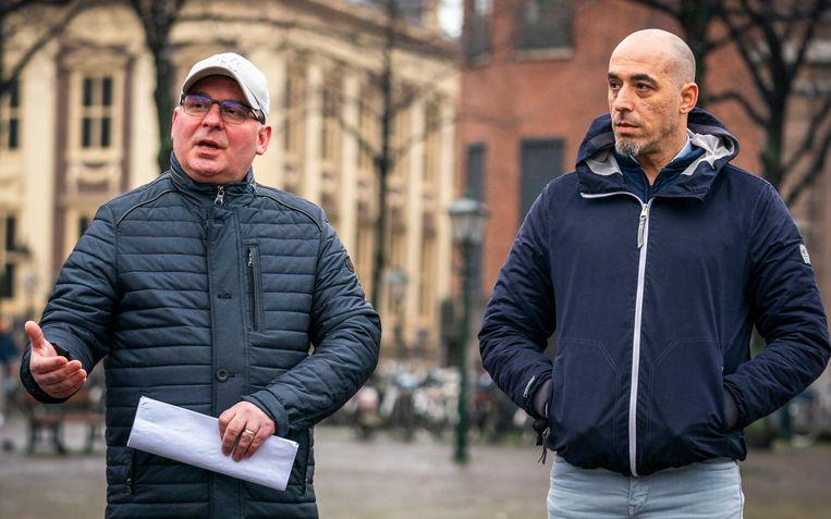 Marcin (links) en Hugo Afecto  vorige week in Den Haag bij een demonstratie tegen de slechte woon- en werkomstandigheden van arbeidsmigranten. Beeld