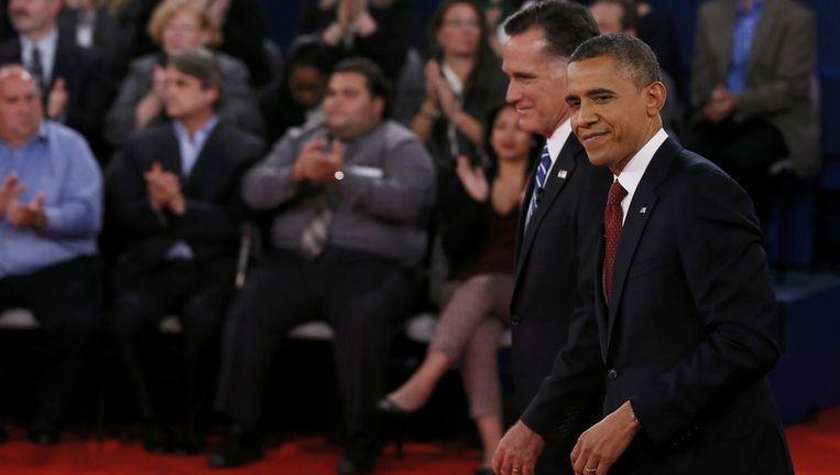 Romney en Obama na een tweede debat in Hempstead, op 16 oktober Beeld reuters