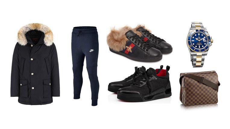 De Woolrichjas (ideaal voor op de scooter), Nike joggingbroek, Guccisneakers met bont (700 euro), Louboutins, Rolex (statussymbool voor alle klassen) en het Louis Vuitton schoudertasje. Beeld -