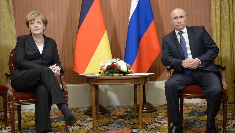 Merkel en Poetin in Deauville. Beeld anp