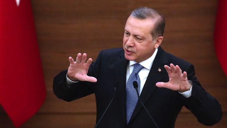 De Turkse president Erdogan tijdens een speech in zijn presidentiële complex in Ankara Beeld anp