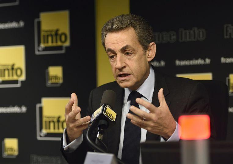 Sarkozy op de redactie van France Info. Beeld afp