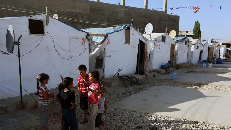 Syrische vluchtelingen in een vluchtelingenkamp in Libanon. Beeld ap