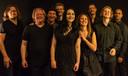 De negen profmuzikanten van de Delftse band Symphonic Rock Night.
