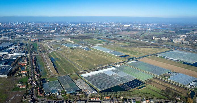 Polder Nieuw Reijerwaard in Ridderkerk vanuit de lucht. De gemeente Barendrecht blijft meedoen aan de plannen voor een bedrijventerrein voor groente- en fruitondernemers.