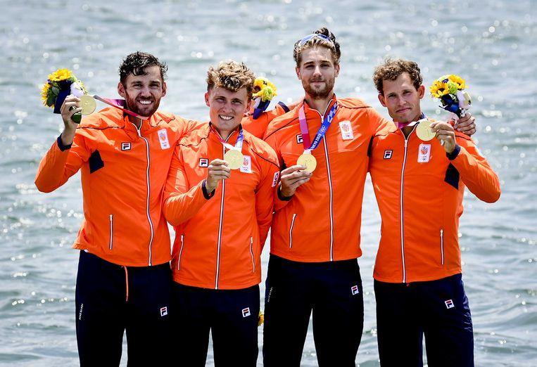Dirk Uittenbogaard, Abe Wiersma, Tone Wieten en Koen Metsemakers, de winnaars van goud in de dubbelvier. Beeld ANP