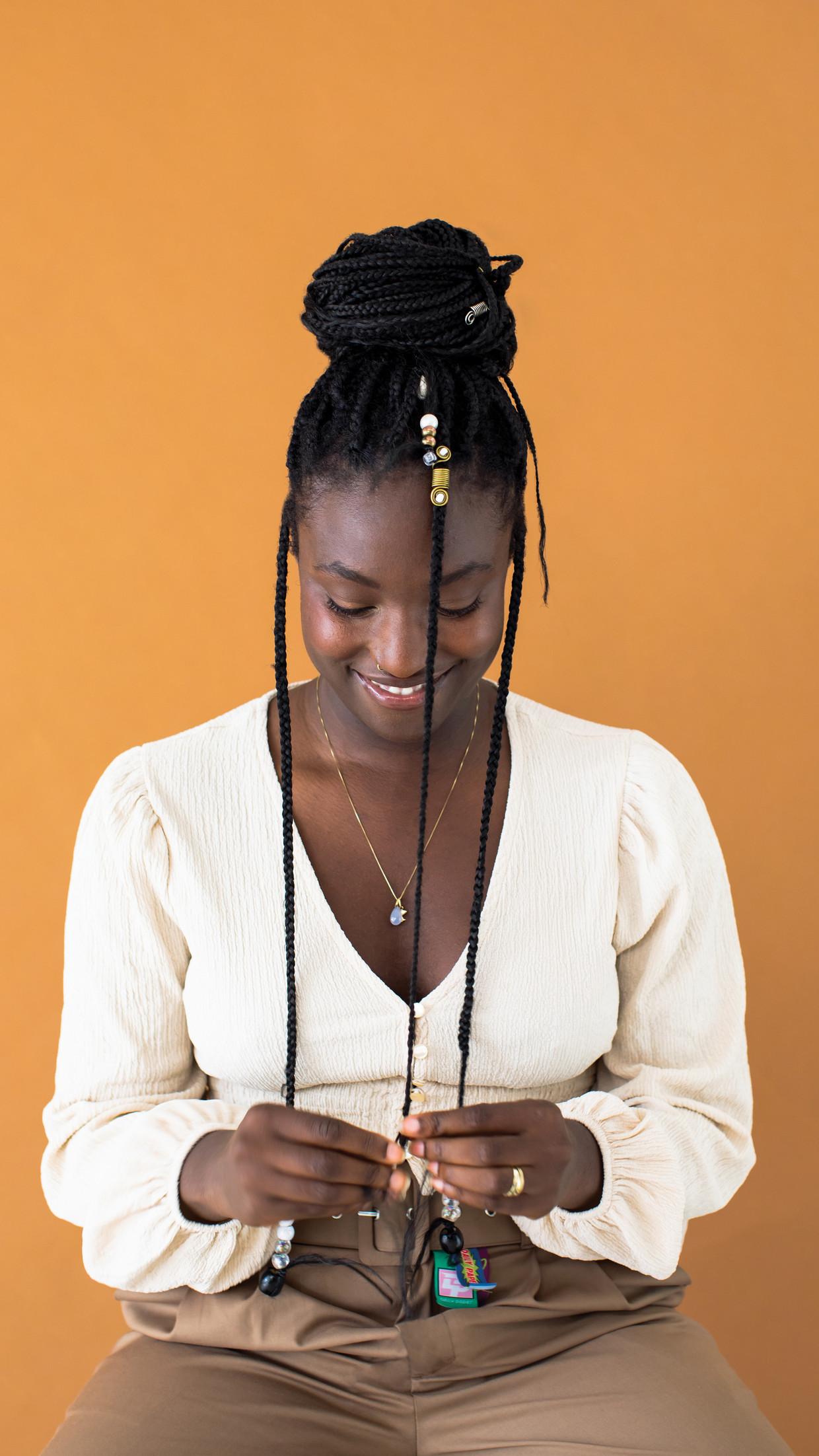 Rudy Asibey: 'Als Nederlander van kleur kun je niet op tv je emoties tonen: voor je het weet ben je weer die boze zwarte vrouw.' Beeld Sharon Jane