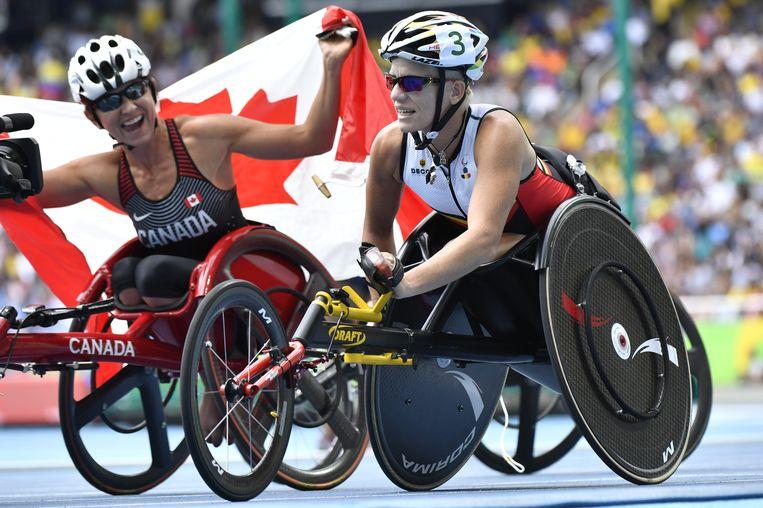 Marieke Vervoort naast de Canadese winnares, Michelle Stilwell. Beeld BELGA