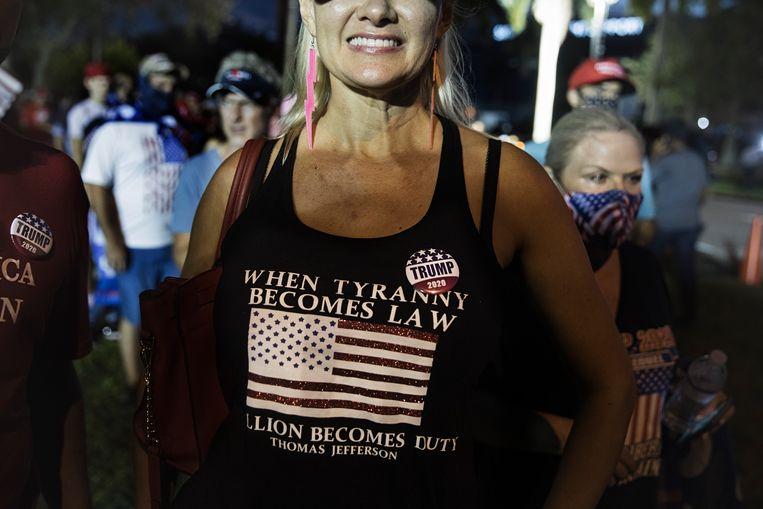 Trump-supporters tijdens een rally in Miami. Latino's zijn een cruciale stem voor Trump in Florida. Beeld Daniel Rosenthal / de Volkskrant