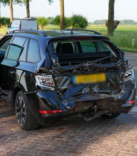 Ongeluk met vrachtwagen en auto in Megen, automobilist gewond