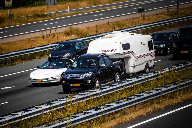 Het belooft een druk verkeersweekend te worden in Europa, met code rood voor het vertrek richting zuiden. Wie naar het buitenland vertrekt, doet dat best op zondag, raadt Touring aan. Beeld ANP