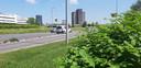 Hartelijk welkom in Rotterdam! Langs de kant van de weg bij het Kralingseplein wappert het groene gevaar de automobilist enthousiast tegemoet.