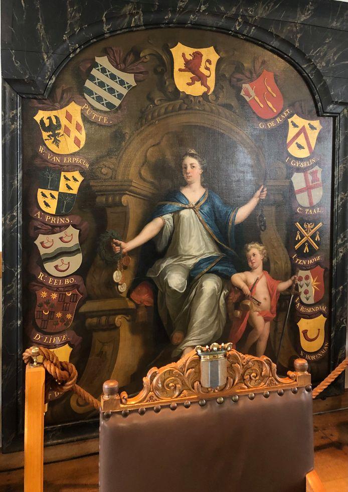 Schouwstuk uit het Hof van Putte met vrouwe Justitia en de wapens van de hoge heerlijkheid Putten en Holland en de familiewapens van de Ruwaard en Leenmannen in de raadzaal van het oude stadhuis in Geervliet. Op de voorgrond staat de stoel van de burgemeester met het oude gemeentewapen van Geervliet.