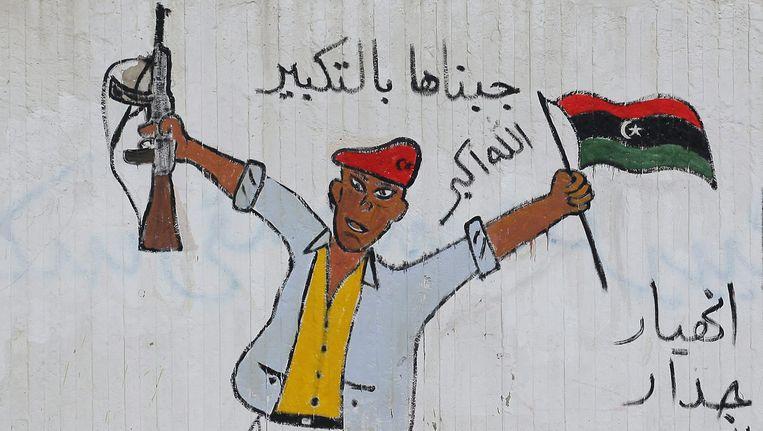 Graffiti op een muur in Tripoli. Beeld EPA
