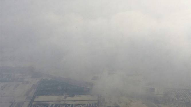 Verstikkende smog brengt verkeer in Peking in de war