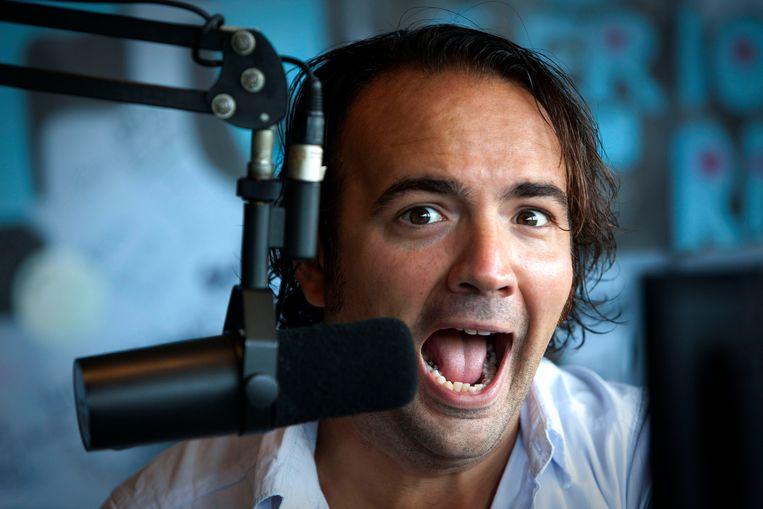 Gerard Ekdom dinsdag tijdens de uitzending van Arbeidsvitaminen in de 3FM studio in Hilversum.  Beeld ADN Beeldredactie
