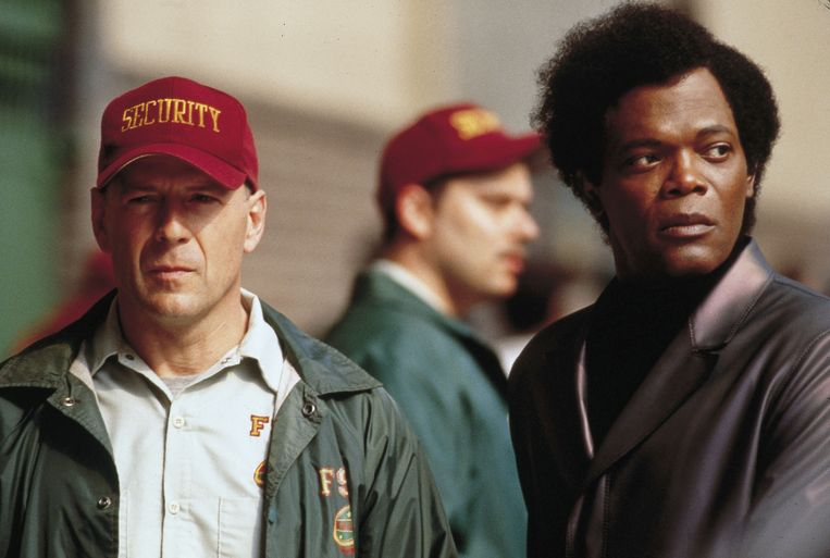 Bruce Willis (links) en Samuel L. Jackson in 'Unbreakable'.  Beeld Kippa