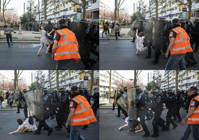 Tijdens een demonstratie in Parijs tegen het beleid van de Franse President, tracht een demonstrante een heel peloton agenten van de oproerpolitie tegen te houden. Ze wordt hardhandig onder de voet gelopen. Foto Stringer