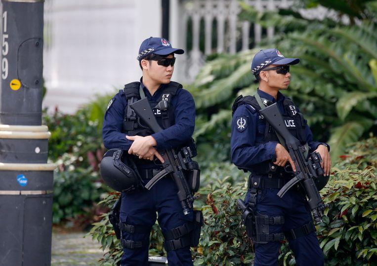 Het veiligheidspersoneel in Singapore staat op scherp voor de ontmoeting tussen Donald Trump en Kim Jong-un. Beeld EPA
