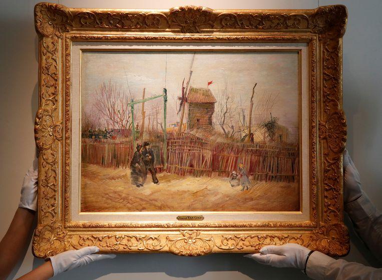 Het schilderij 'Scène de rue à Montmartre van Vincent van Gogh. Beeld Reuters