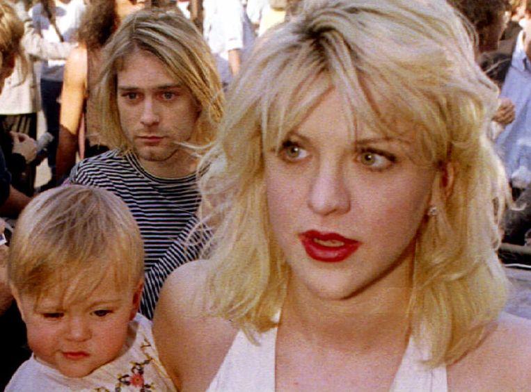 Kurt Cobain met zijn vrouw, Courtney Love en hun dochter, Frances Bean Cobain in 1992. Beeld reuters