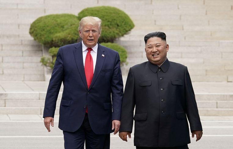 Kim en Trump afgelopen weekend bij de gedemilitariseerde zone in Noord-Korea.  Beeld REUTERS