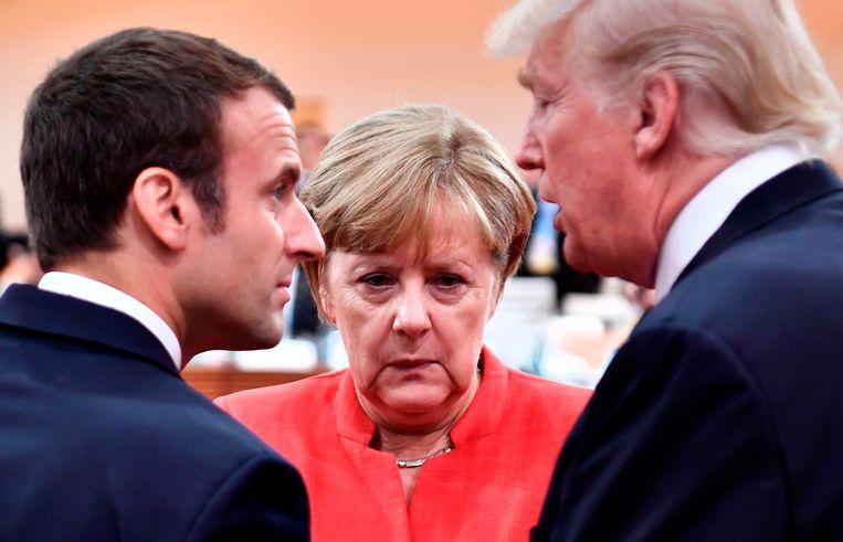 Eerst zette president Trump een streep door het klimaatverdrag van Parijs, nu doet hij hetzelfde met de overeenkomst over het kernprogramma van Iran.  Beeld AFP