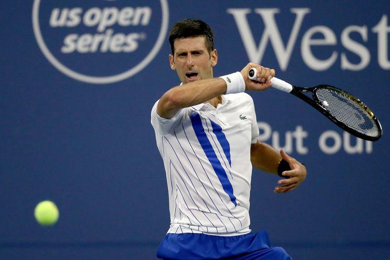 Novak Djokovic wint zijn match tegen Ricardas Berankis in twee sets. Beeld AFP