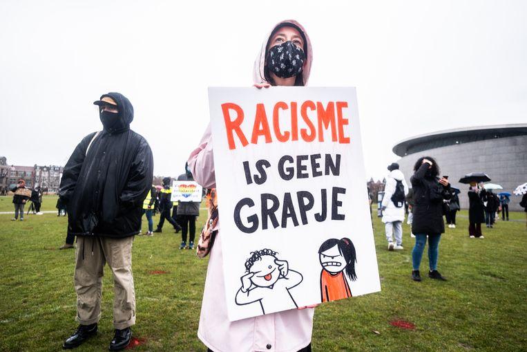 Een betoging tegen anti-Aziatisch racisme, begin april 2021.  Beeld Joris van Gennip