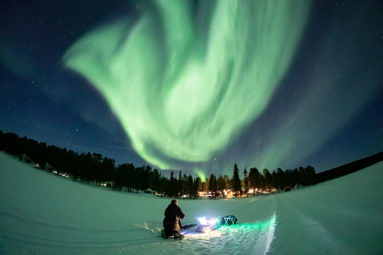 Het Noorderlicht boven het Finse Torassieppi, in maart. Zo helder was het licht hier vannacht niet.  Beeld REUTERS