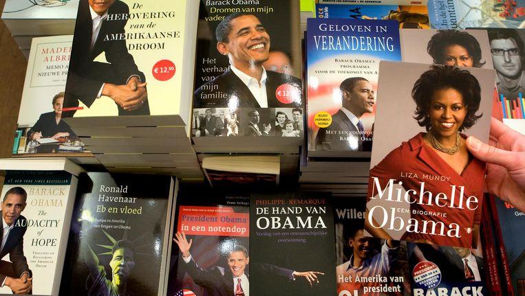 Barack en Michelle Obama schrijven ieder hun eigen boek. Beeld anp